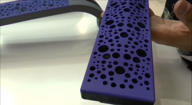 a customized, purple, 3D printed arm rest prototype made from the J750 printer